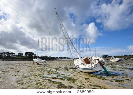 Yacht During Ocean Low Tide In Plouguerneau, Brittany, France