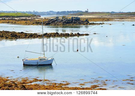 Yacht During Ocean Low Tide In Lilia, Brittany, France