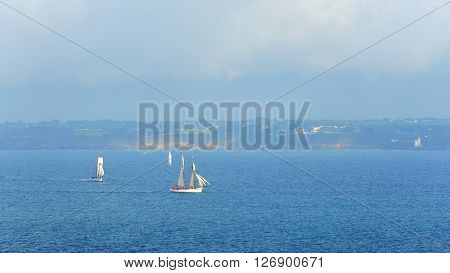 Ships Sailing In The Ocean During Good Weather At The Coasts Of Brittany, France
