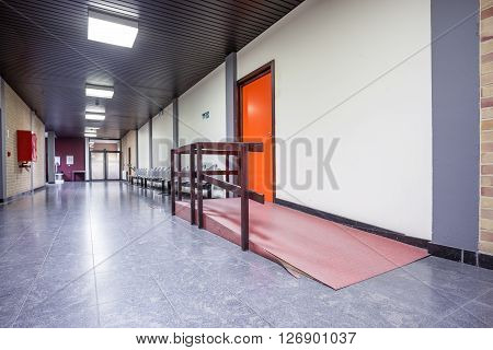 waiting room with a door with an ramp for wheelchair