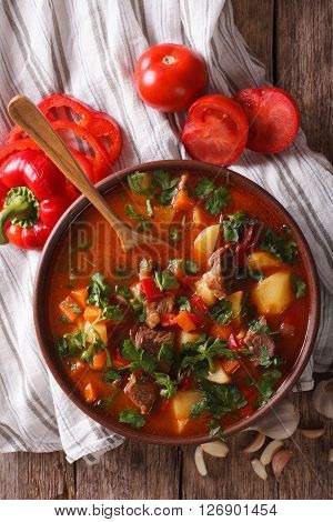 Traditional Hungarian Goulash Soup Bogracs Close-up In A Bowl. Vertical Top View
