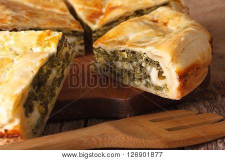 Freshly Baked Greek Pie With Spinach Macro. Horizontal