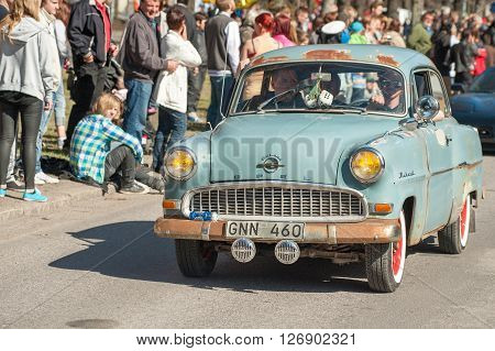 NORRKOPING, SWEDEN - MAY 1: Opel Rekord 1956 at classic car parade celebrates spring on May 1, 2013 in Norrkoping, Sweden. This parade is an annual tradition in Norrkoping on May Day.