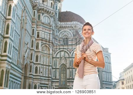 Woman Tourist Standing Near Duomo And Looking Into Distance