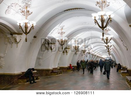 MOSCOW - MARCH 3: People walking at the Arbatskaya metro station on March 3 2016 in Moscow. Arbatskaya was designed by Leonid Polyakov Valentin Pelevin and Yury Zenkevich and build in 1953.
