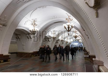MOSCOW - MARCH 3: Blurred people walking in Arbatskaya metro station on March 3 2016 in Moscow. Arbatskaya was designed by Leonid Polyakov Valentin Pelevin and Yury Zenkevich and built in 1953.