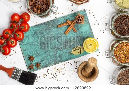 Spices and herbs. Food cuisine ingredients photography fresh cinnamon cloves anise lemon on blue painted wooden board. Mulled wine recipe
