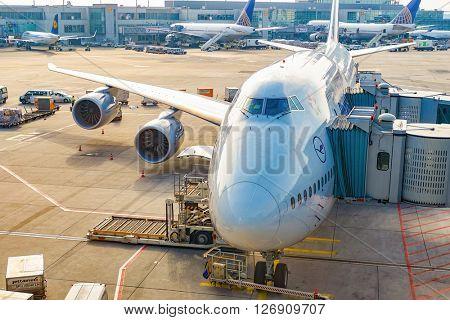 FRANKFURT, GERMANY - MARCH 13, 2016: Lufthansa aircraft docked in Frankfurt Airport. Frankfurt Airport is a major international airport located in Frankfurt