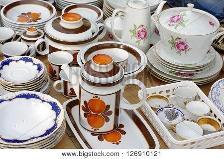 Porcelain tableware retro flea market still life.