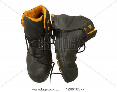 Black work boots isolated on white background. Top view.