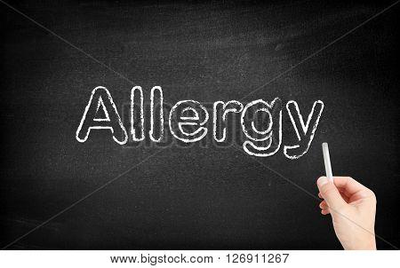 Allergy written on white blackboard