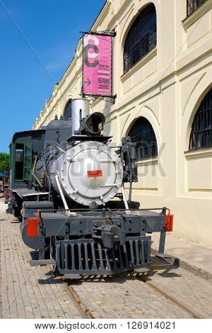 HAVANA,CUBA- APRIL 20,2016 : Old steam train next to the art and handicrafts market in Old Havana
