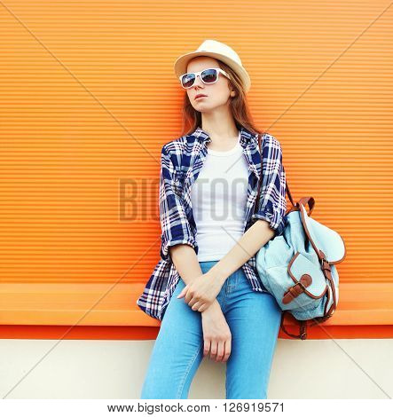Fashion Woman Wearing A Sunglasses With Backpack Over Colorful Orange Background