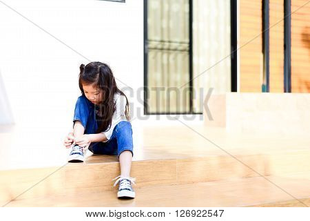 Girl Tie Up Her Shoe