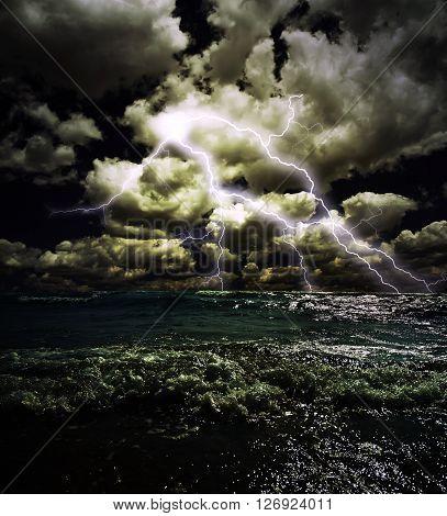 Lightning in the dark sky, stormy sea at night