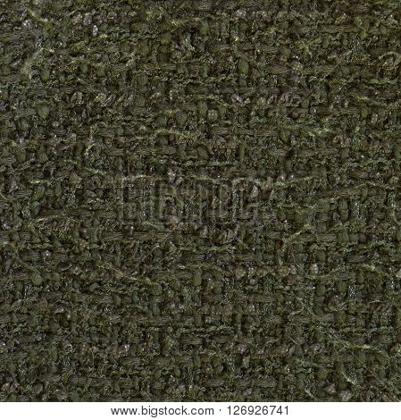 Bottle green woven woolen fabric texture. Complicated melange. Close up fragment of the top view.