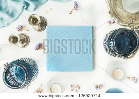 blue wedding or family photo album vintage old-fashioned golden tray candlesticks flowers silk dress isolated on white background. flat lay overhead view