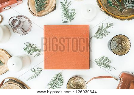 orange wedding or family photo album vintage old-fashioned camera candlesticks candles branches old tray and wooden cuts isolated on white background. flat lay overhead view