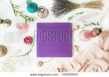 purple wedding or family photo album roses lavender green eucalyptus branches candles candlesticks pink dress isolated on white background. flat lay overhead view