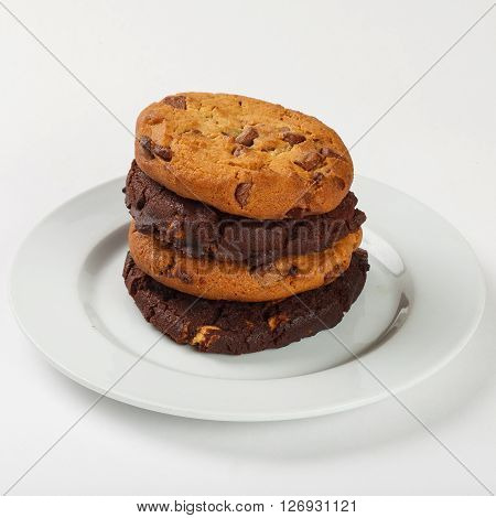 Cookies biscuit with chocolate chips on the plate on white background. Close up side view.