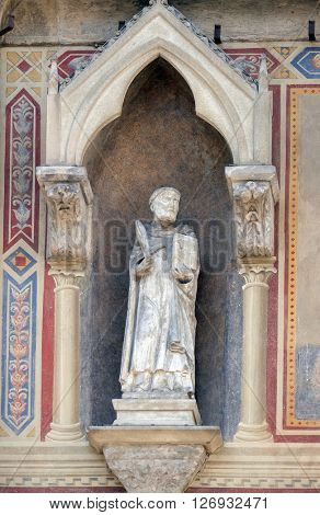 FLORENCE, ITALY - JUNE 05: Saint Peter Martyr, Loggia del Bigallo on Piazza San Giovanni in Florence, Italy, on June 05, 2015