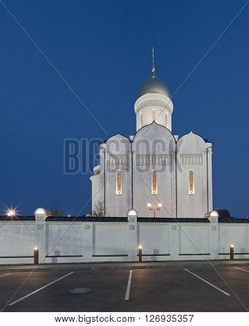 The temple and the fence and street lamps. Architectural lighting.