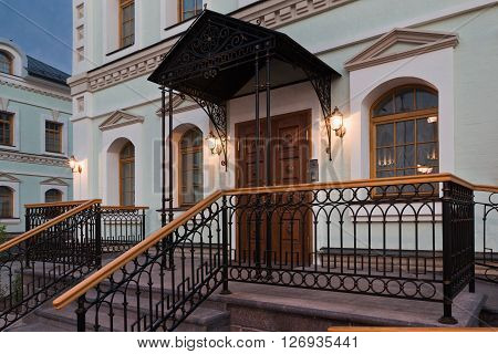The entrance of the refectory in luxury classic style. Stairs railing canopy