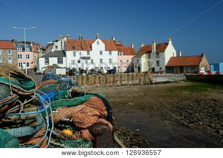Fishing nets stacked up on the harbour wall at Pittenweem