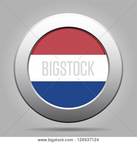 metal button with the national flag of Netherlands on a gray background