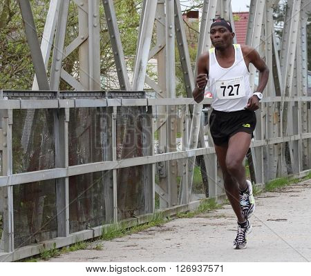 PILSEN, CZECH REPUBLIC - APRIL 23, 2016: Silas Kiprono Too winner of Plzensky pulmaraton (half marathon) run. Most popular international sport event in Western Bohemia.