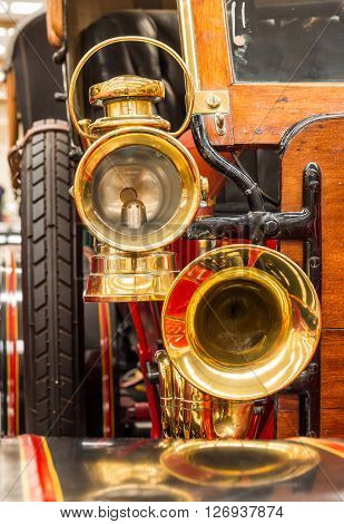Brass vintage horn and a brass head lamp.