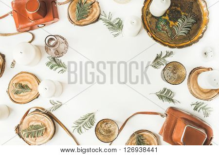 frame with vintage old-fashioned camera candlesticks candles branches old tray and wooden cuts isolated on white background. flat lay overhead view