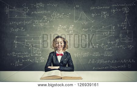 Young woman with disheveled hair against blackboard background