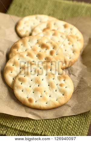 Saltine or soda crackers photographed with natural ight (Selective Focus Focus in the middle of the first cracker)