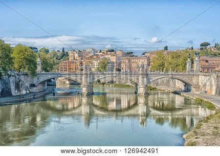 Scenic view of Rome Tiber river and city skyline in sunny day