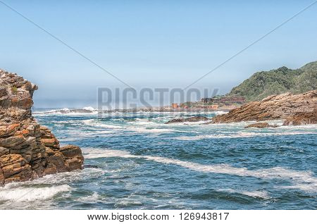 STORMS RIVER MOUTH SOUTH AFRICA - FEBRUARY 29 2016: A view of the Mouth of the Storms River with the restaurant in the back