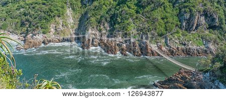 STORMS RIVER MOUTH SOUTH AFRICA - FEBRUARY 29 2016: An aerial view of the three suspension bridges at the Mouth of the Storms River