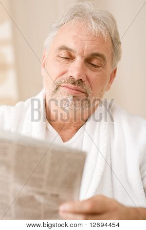 Senior Mature Man Thoughtful Read Newspaper