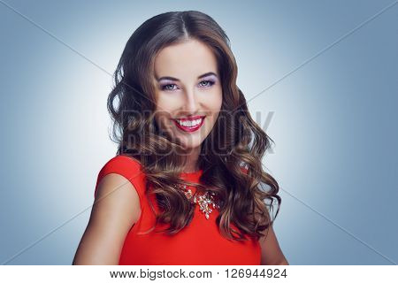 beautiful young model with curly hair and makeup, studio photo