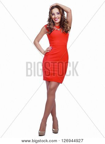 beautiful young model with curly hair wearing a red dress, isolated against white background