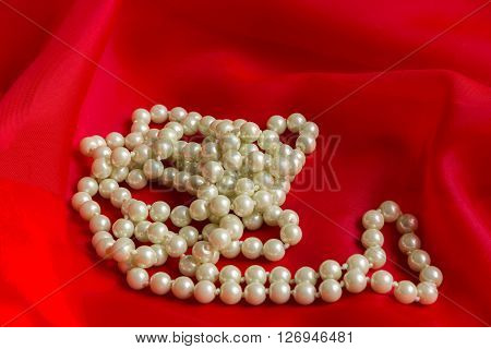 White Pearl Necklace with a red soft silk