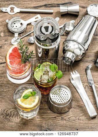 Cocktails with fruits and ice. Bar drink making tools