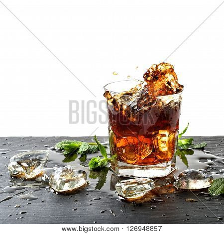 Drink with ice and mint leaves. Liquid splash. Food and beverages