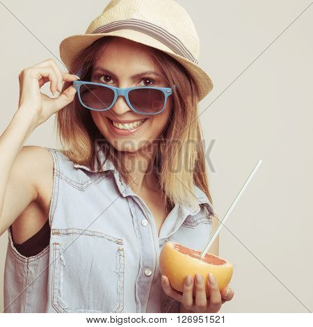Happy Woman In Hat And Sunglasses And Grapefruit