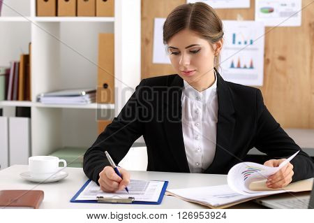 Beautiful Businesswoman Sit At Workplace In Office
