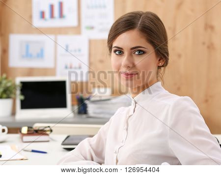 Beautiful Smiling Business Woman Sitting At Office Workplace