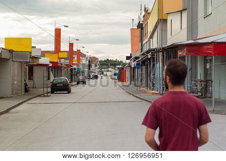 Young adult back view looking forward on the street