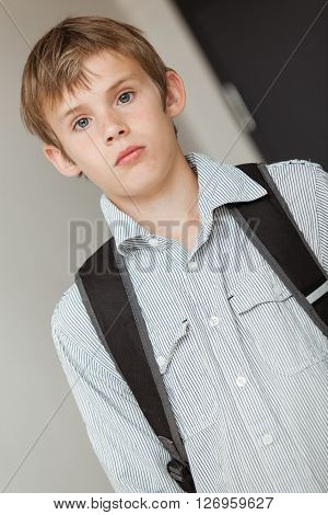 Young School Boy Wearing A Backpack, Tilted View