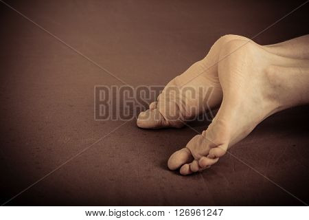 Pair Of Human Feet Laying On Ground