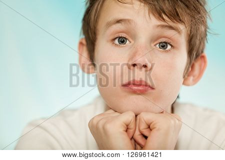 Dubious Young Boy With A Sceptical Expression